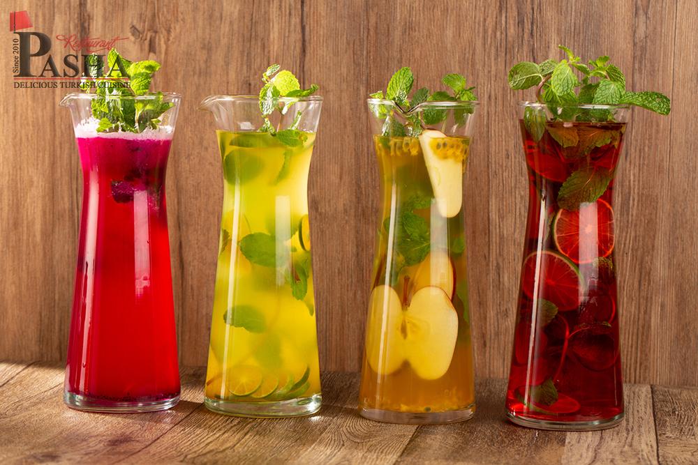 homemade limonade carafe (pink limonade, lemon limonade, passionfruit apple limonade, reddragon limonade)